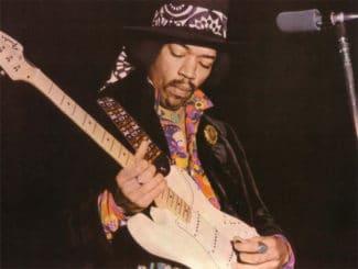 Jimi Hendrix mit seiner E-Gitarre