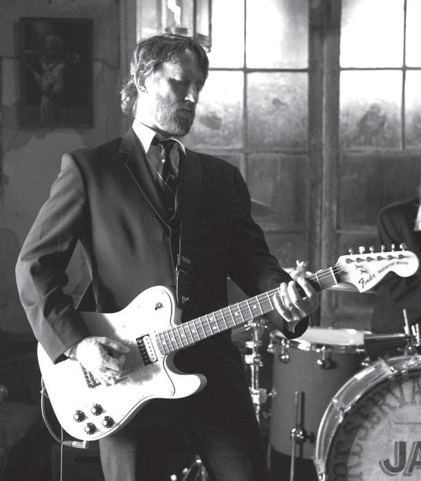 Chris Shiflett mit Gitarre